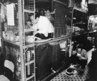 "5──ケージホーム ""Hard to earn a living!"" Photo Album of Cages, Society for Community Organization, 1993"